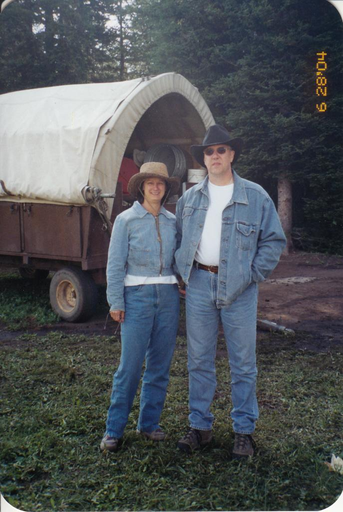 Debbie and her favorite cowboy on a wagon train in the Grand Tetons
